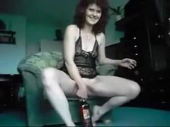 Mature Lady Swallows a Whisky flask
