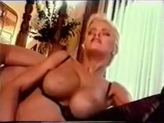 Blonde Nurse with big boobs fucked on the couch