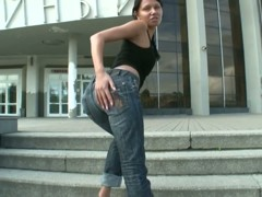Sexy ass girl in jeans flirts with candid street cam