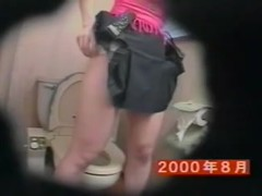 Asian masturbating and pissing on toilet from strong orgasm