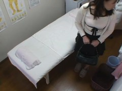 A fresh Asian girl is fucked on the massage table