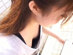 Voyeur street peek at a japanese girls downblouse