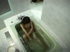 Naked Asian babe washing her hairy pussy and perky small boobs before masturbating