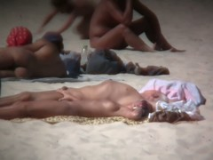 Slender nudist beach babe bares her ass to the hidden cam