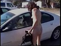 Nude woman driving a car