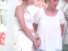 Two lesbian babes are walking around in white shorts