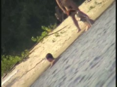 My beach spy cam video of a cute redhead coming out of the water
