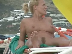 Mature babe with big tits and hairy pussy naked at the beach