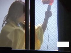 Asian girl dries out hair and masturbates on window spy cam
