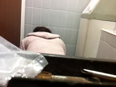 Female bent over the bowl and shot on the toilet cam