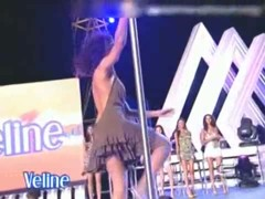 Two pole dancing brunettes on a tv show in an upskirt porno show ass