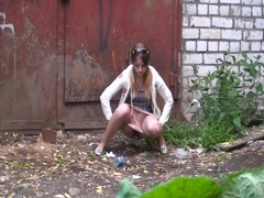 Candid amateur girl gets spied pissing in the street