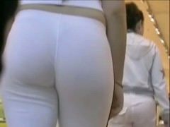 Tall and thick lady with an XL ass in sweats being tailed a by spy cam