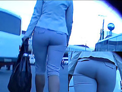 Booty in taut grey breeches