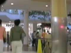 Two goddess models walking around the mall in super tight yoga pants