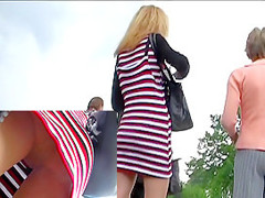 Golden-Haired in hose upskirts outdoors