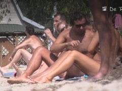 Beach nudist girls show the bodies stretched to crowd
