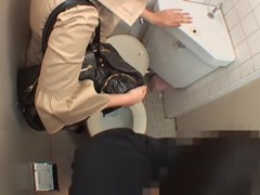 Japanese pussy licked in a rough manner in public toilet