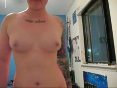 Tatted minx flaunts her tits on cam