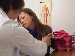 Teen Japanese toyed silly with a vibrating toy on Gyno exam