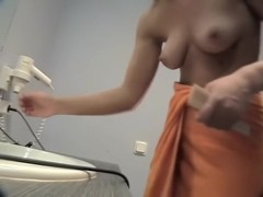 Topless girl in changing room drying out her hair