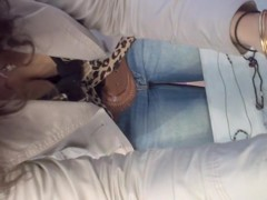 Sexy girl in tight blue jeans exciting down blouse
