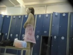 Changing room spy cam girl is putting on her panty