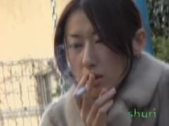 Leggy oriental tramp smoking some cigarette during wild sharking attack