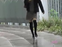 Asian babe gets a nasty skirt sharking on a rainy day.