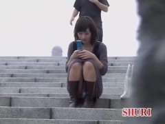 Amative Asian slag gets involved in street sharking while typing text message