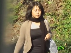 Plump Japanese MILF recorded with no panties during sharking