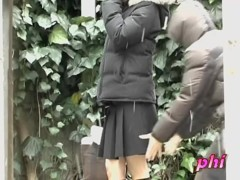 Asian babe gets a cold skirt sharking on a snowy day.