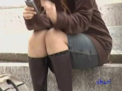 Shy attractive honey playing with her phone during quick sharking scene