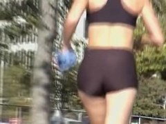 Tiny tight shorts and top on the candid running babe 01d