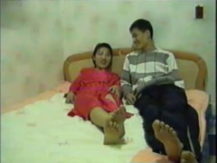 A woman and a man in asian hot sex video.