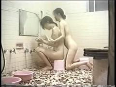 Jap girls enjoy in hidden cam lez sex video in the bathroom