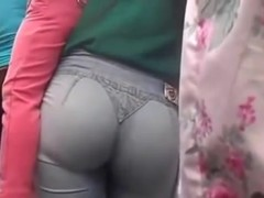 Perfect big booty in blue jeans got in a street candid video