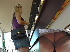 Upskirt video with blonde woman in the short jean skirt