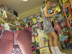 Babe filmed by spy upskirt camera in the local store