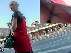 Public upskirt of the blonde dame at the bus station