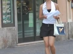 Braless street cute girl walking and bouncing