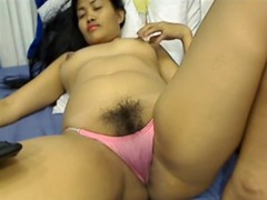 Solo Japanese honey with a unshaved pussy
