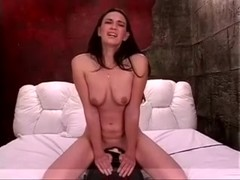 Here is an aspiring darksome brown chick riding a sybian