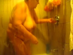 My morbidly overweight mature wife in the shower room naked
