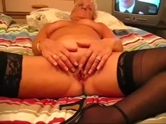 Golden-Haired mature wife spreads her legs in daybed to show her muff