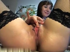Hot girl in stockings plays with her wet vagina
