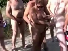 Milf gives free handjobs at a nude resort and the guys start to line up