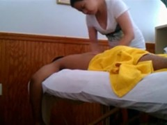 Black guy gets a massage from an asian girl with happy ending