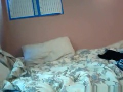 girl takes off her panties after a long day at school and plays with a toy on her bed