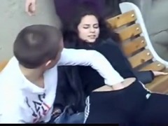 girl slut lets 2 friends play with her tits and pussy on a bench in public